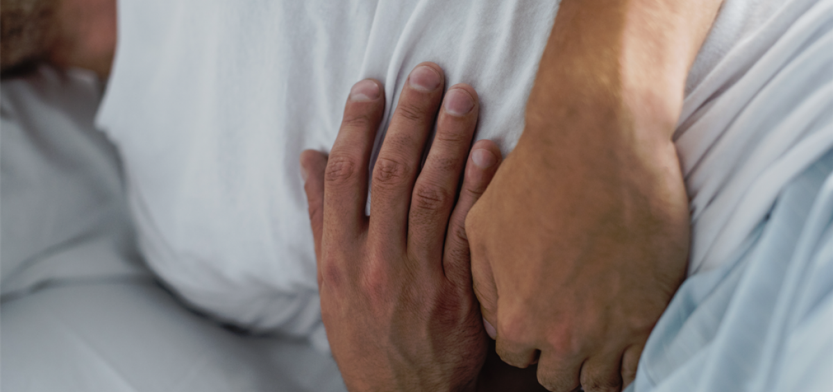 Man suffering from inflammation and stomach pain